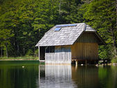 Fishing lodge with Solar array — Stock Photo