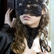 Cute girl in masquerade mask — Stock Photo