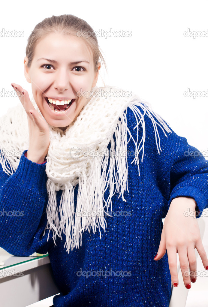 Beautiful woman dressed with blue sweater and red finger nails, with expression on her face of surprise and laughter, on white background. — Stock Photo #8704923