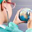 Doctor checkin status health of the earth — Stock Photo