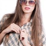 Beautiful girl undressing — Stock Photo