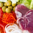 Raw beef fillet with vegetables — Stock Photo