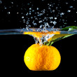 Orange  dropped into water — Stock Photo