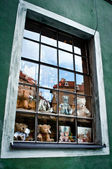 Teddy bears and Krumlovs reflection in the window — Stock Photo