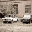 Stock Photo: Two broken half-rotten old cars