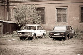 Two broken half-rotten old cars — Stock Photo