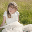 Girl communion dress - Stock Photo