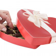 Woman's hand taking chocolate candy — Stock Photo #9013429