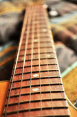 Acoustic guitar, strings and handle detail — Stock Photo