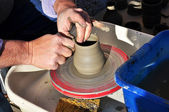 Artisan creates a clay pot with a lathe — Stock Photo