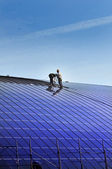 Installation of solar panels on the roof of a building — Stock Photo