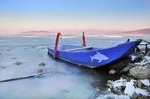 Boat on frozen Trasimeno lake, Italy — Stock Photo