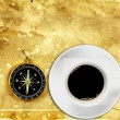 Black coffee in white cup with compass — Stockfoto