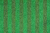 Umělé zelené trávě textura — Stock fotografie