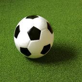 Soccer ball on grass — Stock Photo