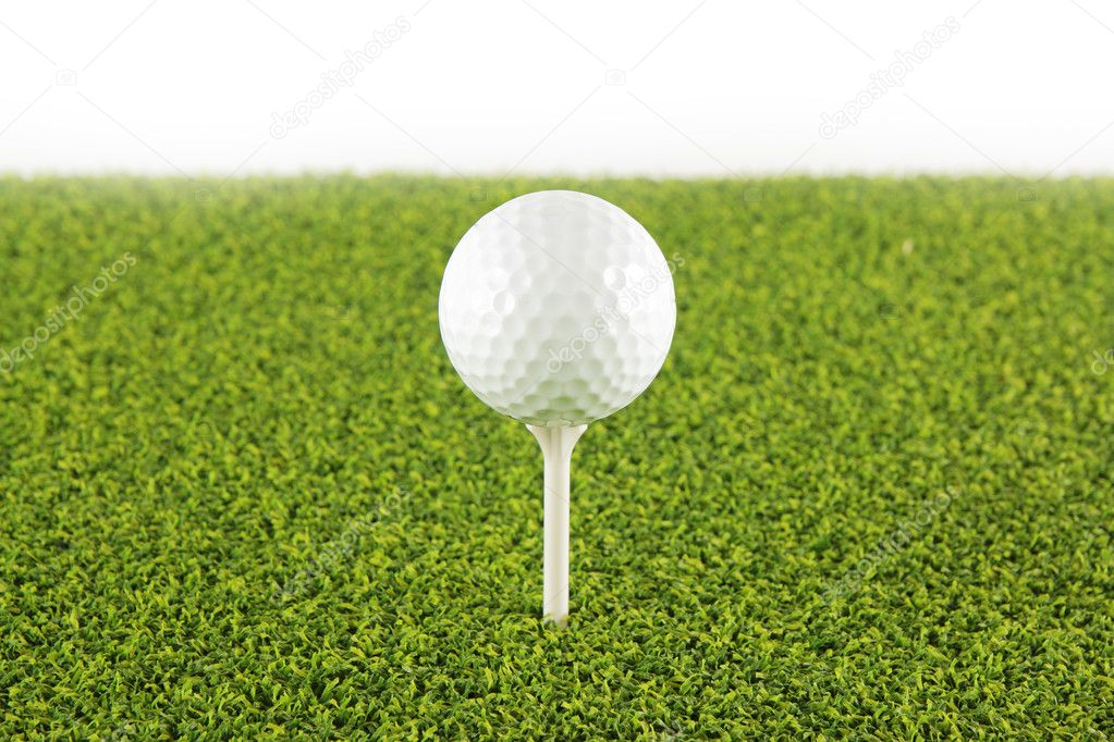 Golf ball on tee ,Focus on the ball. — Stock fotografie #10659363