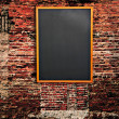 Black board on wall — Stock Photo