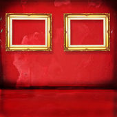 Gold wod frame in red room — Stock Photo