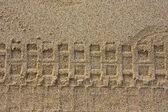 Däck tryck på sand — Stockfoto