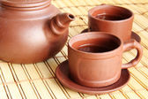 Chinese teapot, two cups and tea — Stock Photo