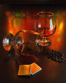 Two glasses of brandy with chocolate — Stock Photo