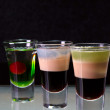 Three cocktails layered shots - Foto Stock