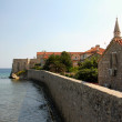 The old fortress walls of Budva on the background of the sea — Stock Photo
