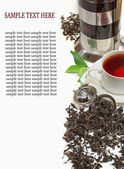 Black iron asian teapot with sprigs of mint for tea — Stock Photo