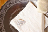 Luxury bath or shower set with towel, brush and shells on silver scale — Stock Photo