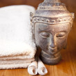 Luxury bath or shower set with towel, buddha and shells on wooden table — Stock Photo #8651467