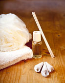 Luxury bath or shower set with towel, sponge, perfume and shells on wooden — Stock Photo