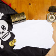 Pirate blank map with treasure, compass and flag with skull — Stock Photo #9340743