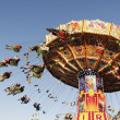 Chairoplane at the Oktoberfest - Stock Photo