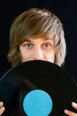 Man with vinyl record — Stock Photo
