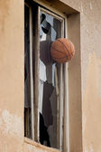 Basketball hitting glass window — Stock Photo