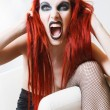 Expressive gothic woman with artistic makeup — Stock Photo