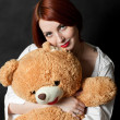 The girl with a teddy bear - Stock Photo