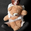The girl with a teddy bear — Stock Photo