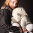 The attractive girl with a soft toy - Stock Photo