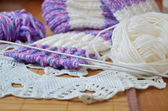 Threads and spokes with knitting — Stock Photo