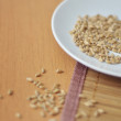Wheat grains in a white plate — Stock Photo