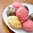 Macaroons on the white plate — Stock Photo