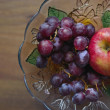 Stock Photo: Grape and apple on plate