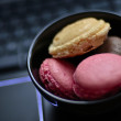 Stock Photo: Macaroons on keyboard