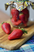 Ripe large strawberry in bank — Stock Photo