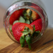 Stock Photo: Ripe large strawberry in bank