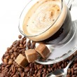 Hot coffee, coffee beans and brown sugar — Stock Photo