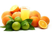 Ripe oranges , green lime and juice. — Stock Photo
