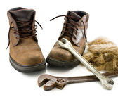 Boots and metalwork tools — Stock Photo