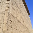 Hieroglyphic carvings on an egyptian temple wall — Stock Photo #8958076